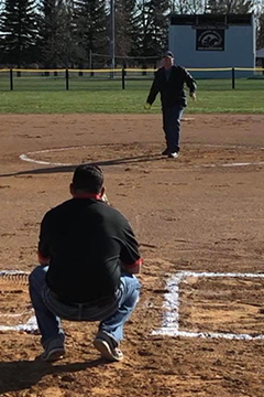 Dale throwing out first pitch for wilton girls fast pitch softball
